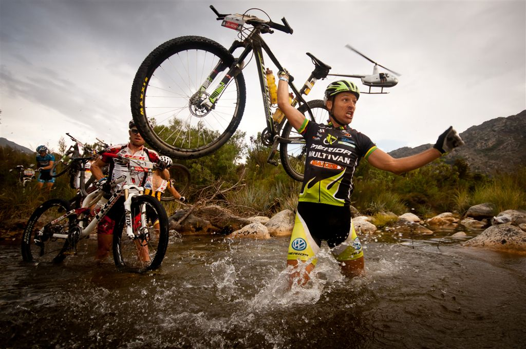 81440-110330_RSA_CapeTown_CapeEpic_Stage3_Tulbagh-Worcester_Naef_FlueckigerL_watercrossing_helicopter_havingfun_2_by_Cerveny.jpg