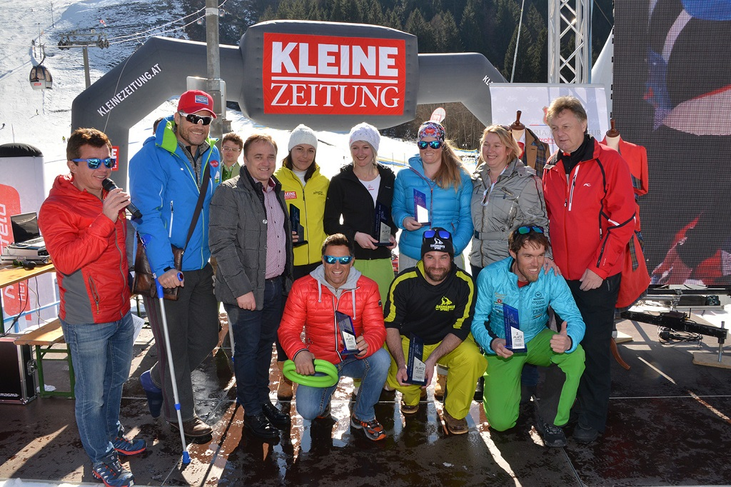 A 6. Schlag das Ass - A világ leghosszabb sífutóversenye büszke győztesei trófeáikkal és a sérült házigazdával Armin Assingerrel Forrás: www.nassfeld.at/hu